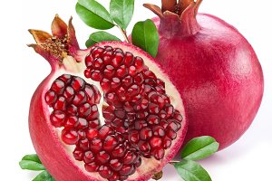 Pomegranate fruit with green leaves