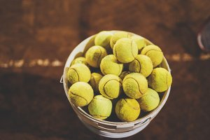 Yellow tennis balls on a court