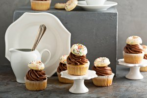 Cupcakes with chocolate frosting and little donuts