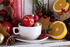 Tea cup with decorations, cookies and oranges for Christmas