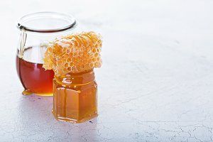 Jar of honey and honeycomb