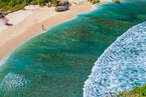 Beautiful Long White Waves and Crystal Clear Water on Atuh beach, Nusa Penida, Bali, Indonesia