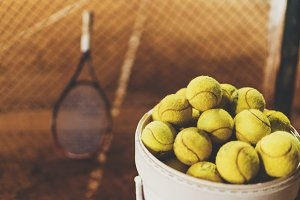 Tennis balls and racket on a court