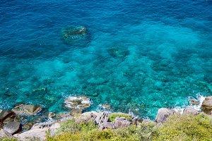 Nangyuan island, West Side, Clear Blue Water Hitting Rocks, Thailand