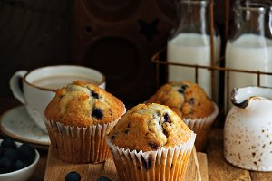 Freshly baked blueberry muffins in a rustic setting