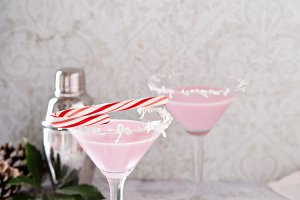 Peppermint martini cocktail with coconut flakes rim