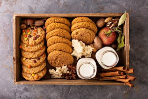 Box with variety of fall cookies and milk bottles
