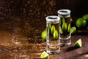Tequila shots with lime and sea salt, selective focus