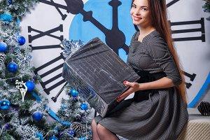 Girl holding a Christmas gift.