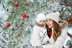 Family in winter forest. Christmas
