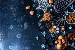 Christmas baking background. ingredients, spices, nuts, cookie cutters, cones, decoration