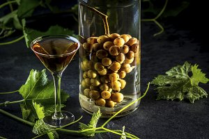 Chilean brandy aguardiente with whole bunch of grapes inside bottle