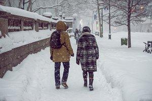 People walking on winter city street