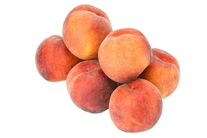 Fresh yellow peaches isolated
