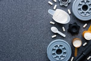 dumbbells and sports supplements