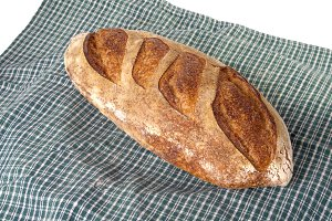 Fresh baked peasant batard on cloth