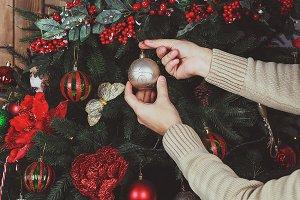 Man decorating the Christmas tree