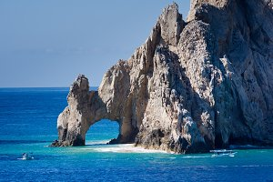 El Arco rock formation with boats