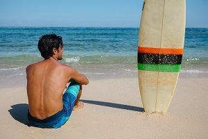 Male surfer relaxing