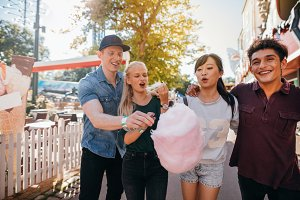 Friends eating cotton candy