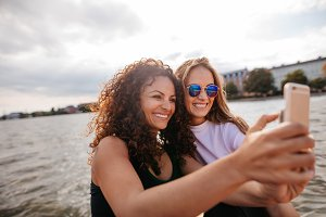 Female friends taking selfie