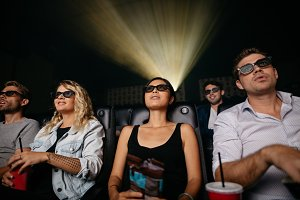 Young people watching 3d movie