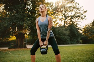Strong young woman exercising