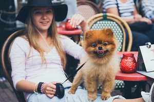 girl with pomeranian spitz