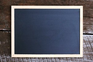 Blackboard on a wooden table