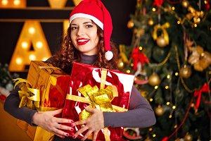 Girl and two Christmas gift.
