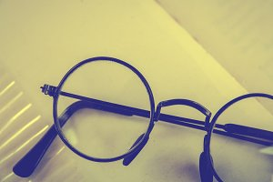 Spectacles and book , vintage styled