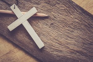 cross on wooden table