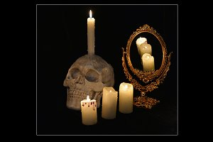 Skull, mirror and candles