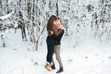 Happy couple in snow park
