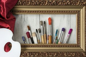 Brushes, palette and a picture frame