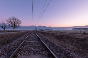 Railroad tracks in the morning mist