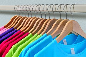 Women's T-shirts hanging on hangers