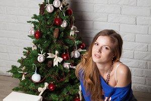 girl near New Year's tree
