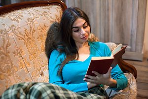 Woman is reading a red book
