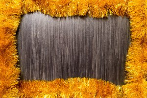 Gold tinsel Christmas decoration.