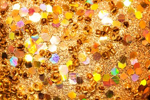 Gold glitter texture with rings and various geometric figures. Background abstract.
