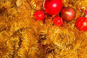 Gold tinsel and red christmas balls. Christmas decoration.
