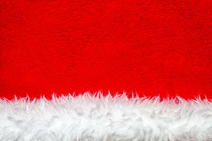 Christmas hat background. White and red texture.
