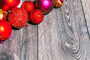 Christmas red toys and decoration.On white wood surface.