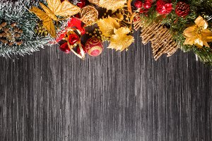 Christmas background with festive decoration and toys.On dark wood surface.