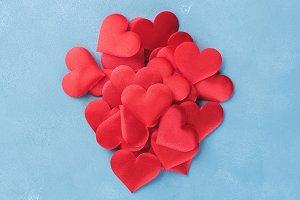 Red hearts on textured background. Vertical valentine