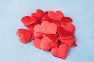 Red hearts on textured background