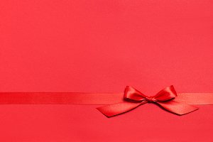 Red ribbon on gift, shopping concept