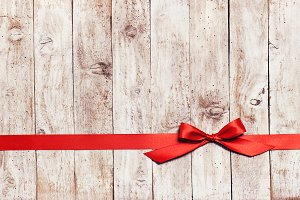 Red ribbon on wood, shopping concept