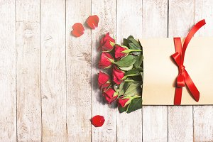 Red roses on wood, holiday concept